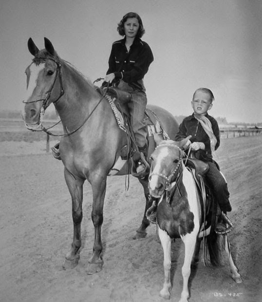 barbara-stanwyck-and-son-dion-on-horseback
